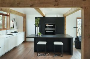 Courtright black and white painted minimal kitchen with wood beams 01