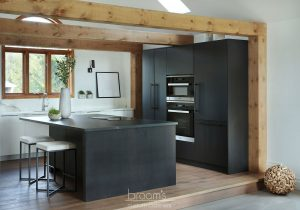 Courtright black and white painted minimal kitchen with wood beams 03