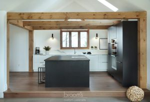 Courtright black and white painted minimal kitchen with wood beams 04
