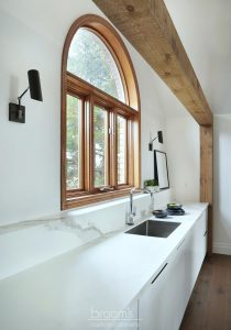 Courtright black and white painted minimal kitchen with wood beams 07