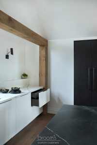 Courtright black and white painted minimal kitchen with wood beams 10