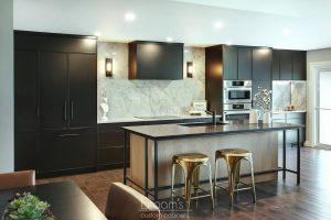 Faircloth black painted cabinets with natural wood and industrial island 01