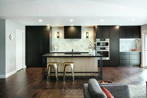 Faircloth black painted cabinets with natural wood and industrial island 02