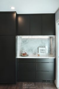 Faircloth black painted cabinets with natural wood and industrial island 04
