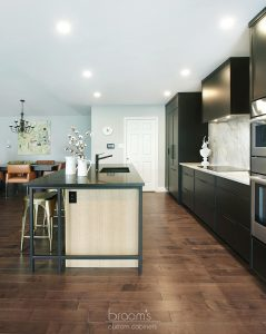 Faircloth black painted cabinets with natural wood and industrial island 06