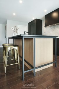 Faircloth black painted cabinets with natural wood and industrial island 07