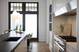 Heritage white painted custom cabinets with black countertop 06