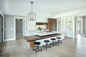 Otterview white and natural wood kitchen with unique island 02