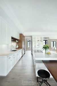 Otterview white and natural wood kitchen with unique island 03