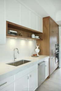 Otterview white and natural wood kitchen with unique island 06