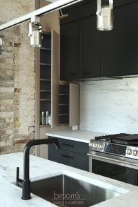Princess black painted kitchen with exposed brick 06