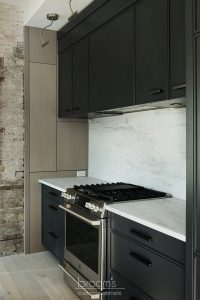Princess black painted kitchen with exposed brick 07