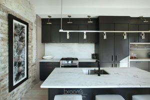 Princess black painted kitchen with exposed brick 08