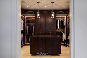 and beyond - dark wood custom closet with island 21