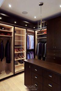 and beyond - dark wood custom closet with island 22