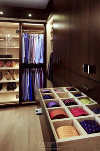 and beyond - dark wood custom closet with island 23