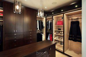 and beyond - dark wood custom closet with island 24
