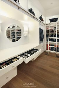and beyond - white painted custom closet with island 10