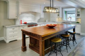 white painted custom kitchen with wood island