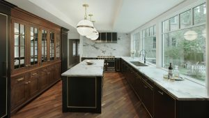 contemporary black and wood kitchen with brass metal details